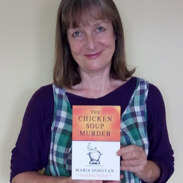 Me holding my novel for our first photo
